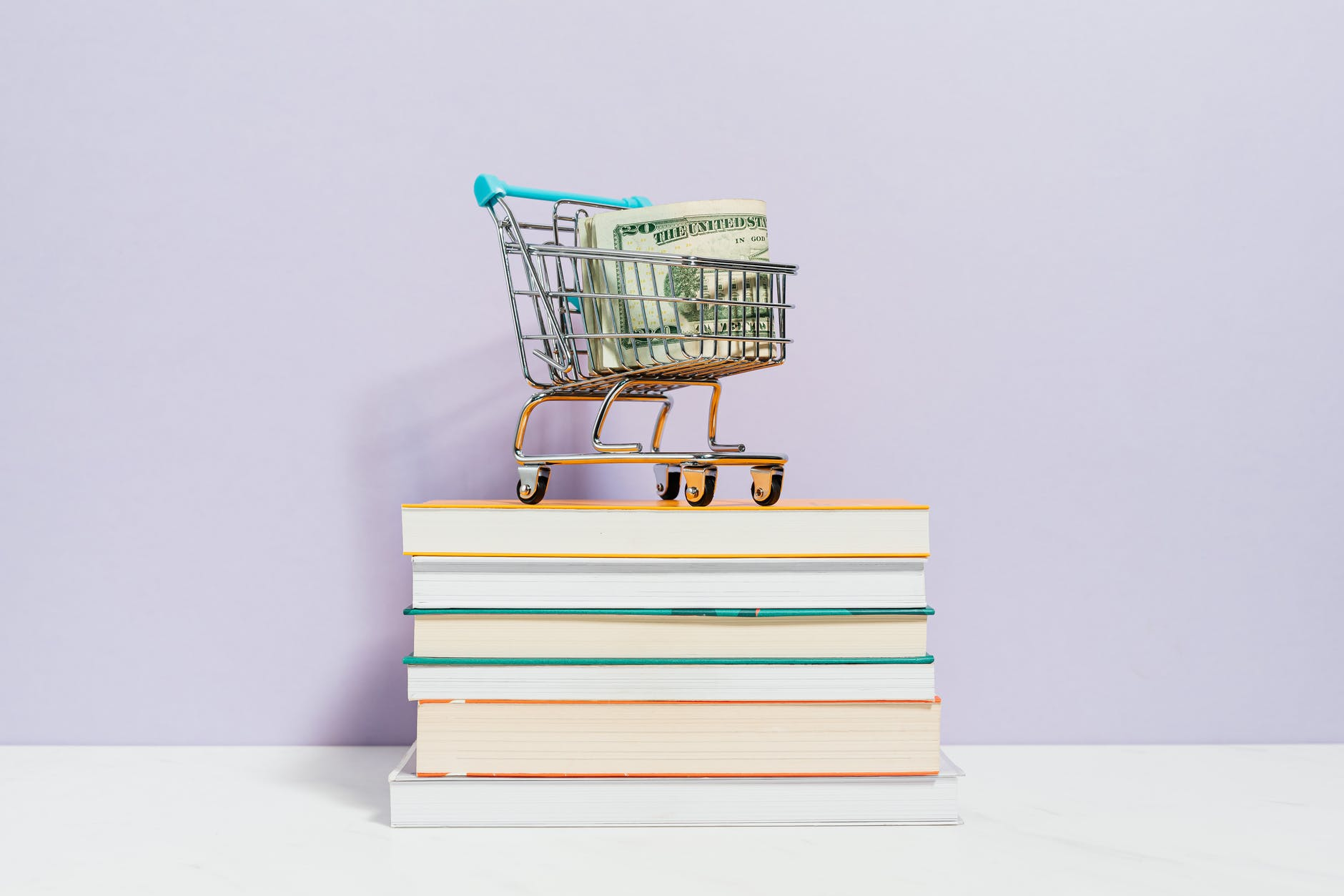 shopping cart on top of books