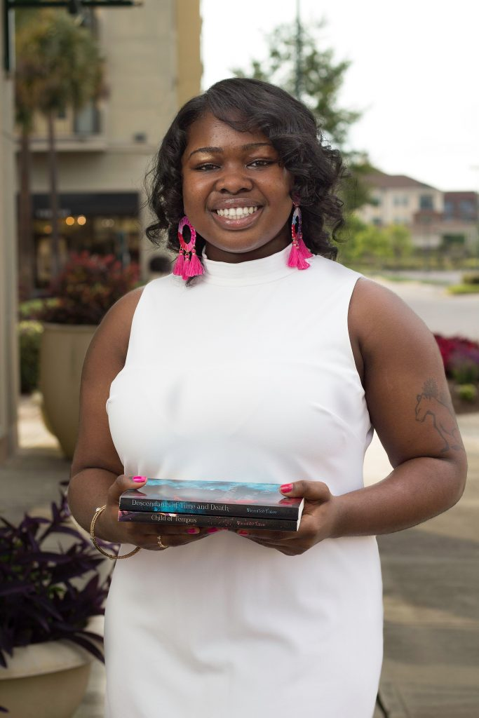 Author and blogger winnifred tataw holding her two books