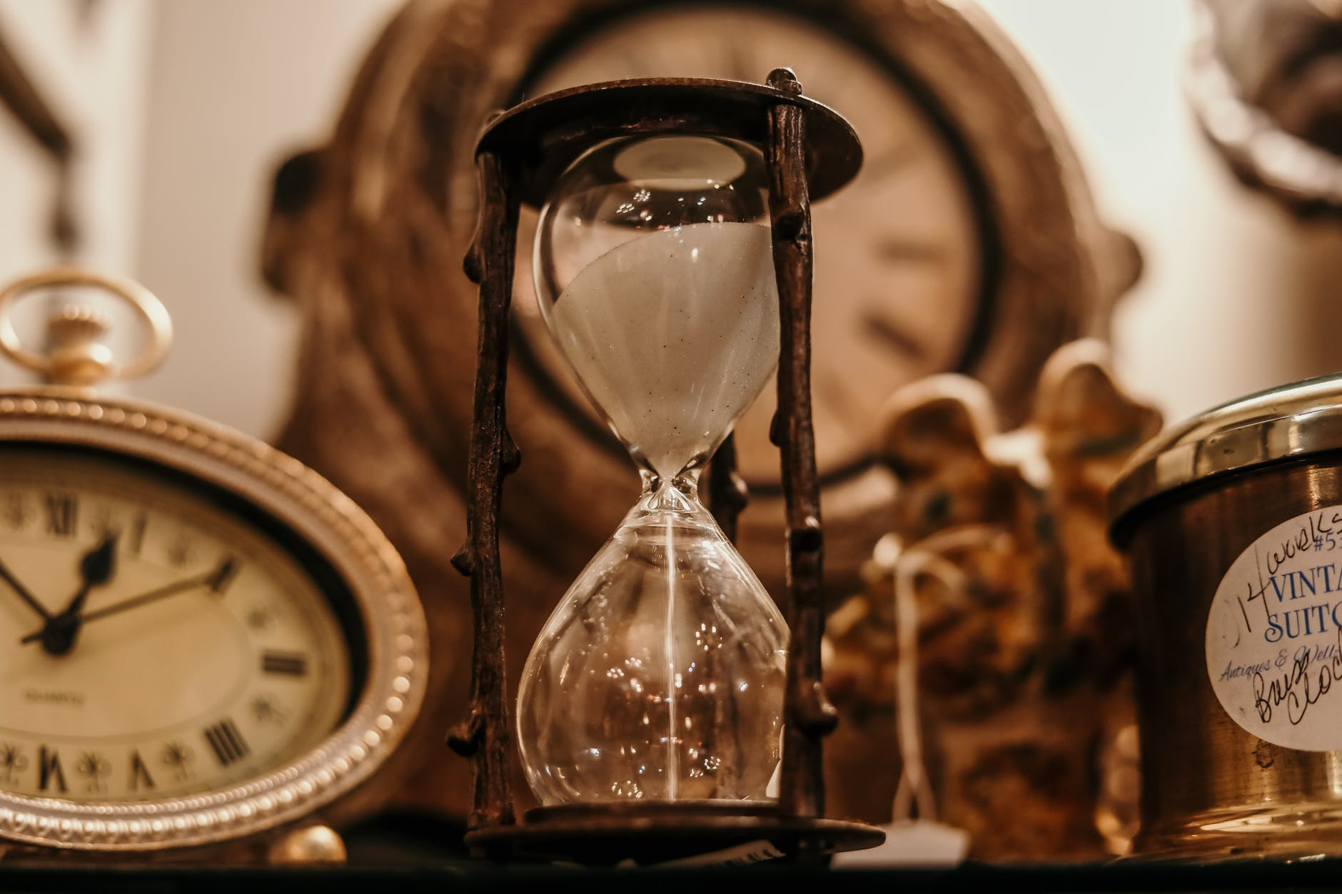 shallow focus of clear hourglass; child of tempus; god of time
