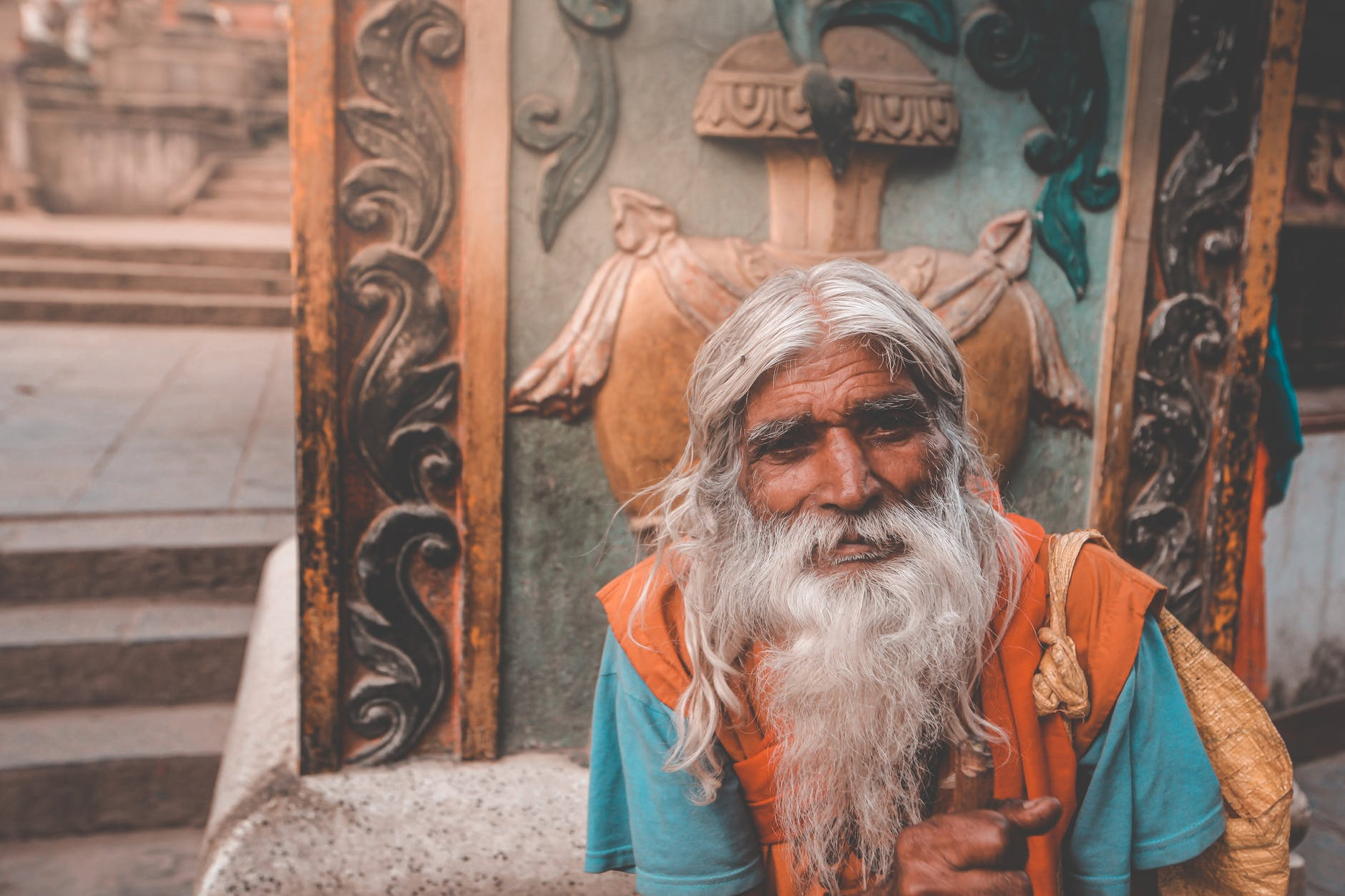 elderly hindu man with gray beard in town; stock character; old wise person