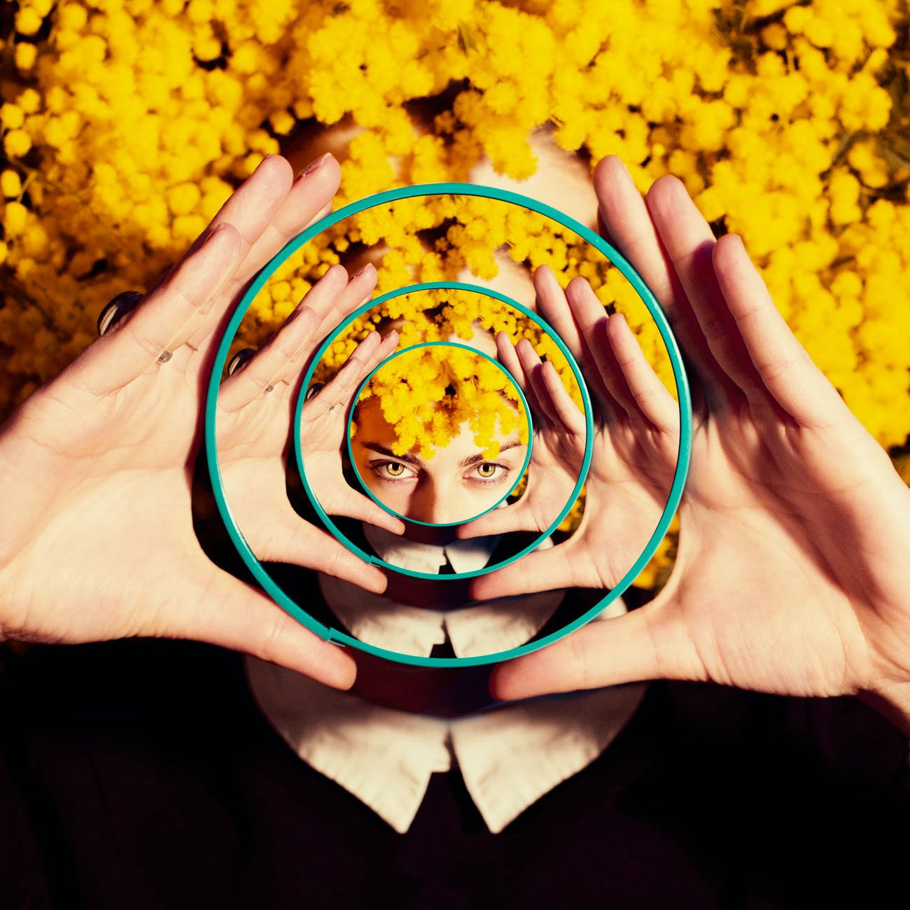photo of woman holding a mirror; What is Magical Realism?