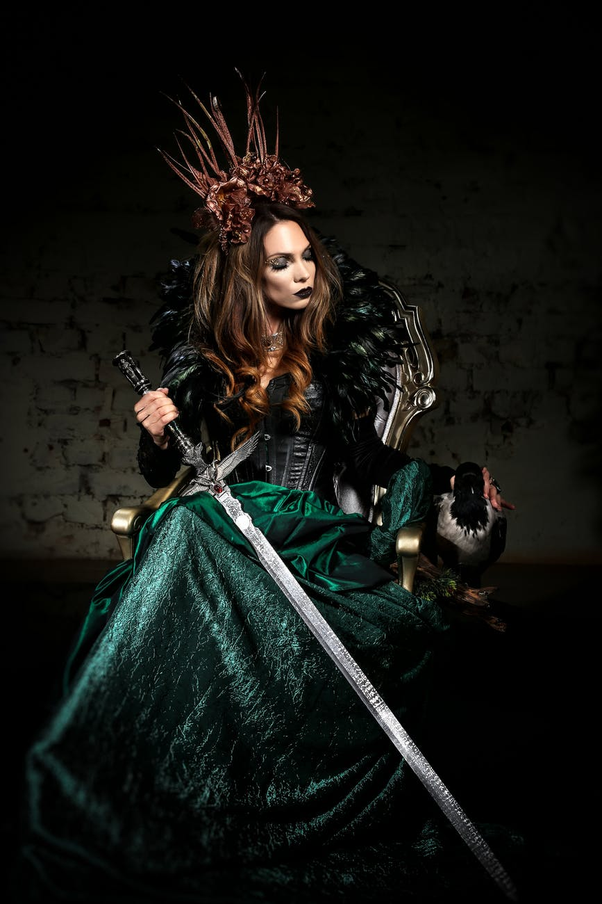 woman wearing a costume holding a sword