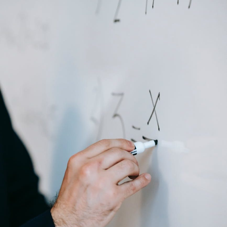 person pen working writing; college professor
