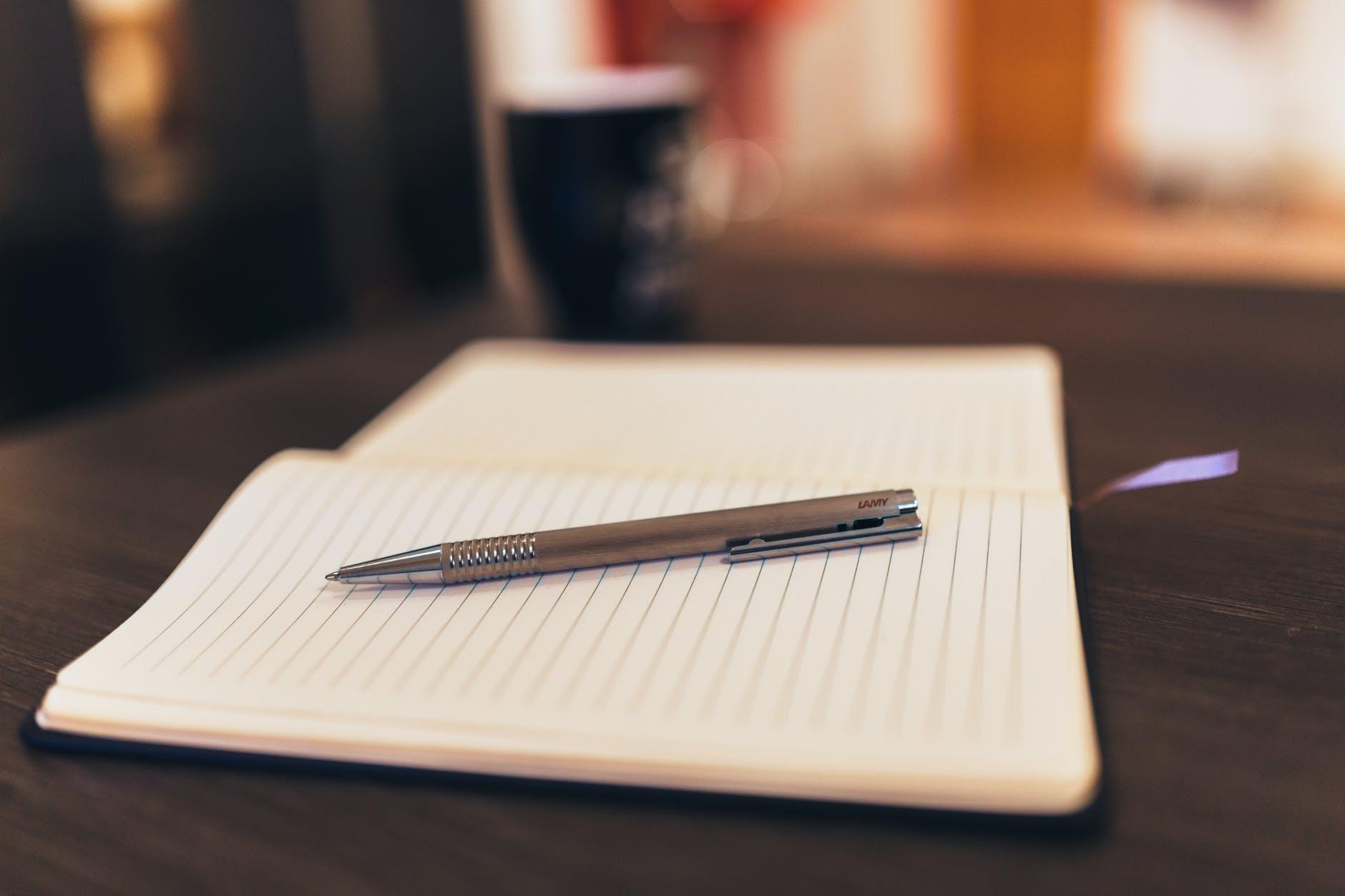 coffee notebook pen writing; writers weeks